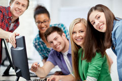 Happy high school students in computer class Stock Photo