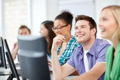 Happy high school students in computer class Royalty Free Stock Photo