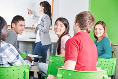 Happy high school students. At math class chatting Stock Photography