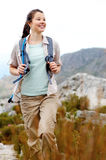 Happy hiker. Carefree brunette girl walks outdoors hiking and exploring. she is cheerful and happy stock photos