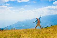 Happy hiker. In mountains, beautiful landscape in background Stock Photography
