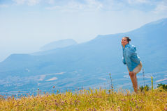 Happy hiker. In mountains, beautiful landscape in background Royalty Free Stock Photo