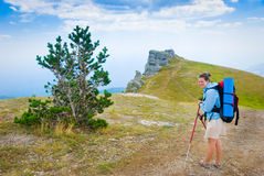 Happy hiker. In mountains. Landmark - Ghost Valley, Demerdji, Crimea, Ukraine Stock Photo
