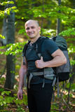 Happy hiker with backpack Stock Photo