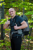 Happy hiker with backpack Royalty Free Stock Photo
