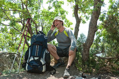 Happy hiker calling home Stock Image