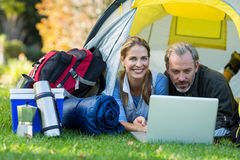 Happy hiker couple using laptop. In tent Stock Photo