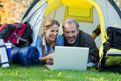 Happy hiker couple using laptop Royalty Free Stock Photography