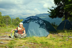 Happy  hiker in front of camp tent Stock Photography