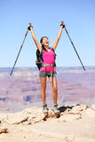 Happy hiker by Grand Canyon cheering. And celebrating with arms raised up enjoying the beautiful scenic landscape. Hiking woman wearing backpack and outdoor Stock Images