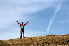 Happy hiker with hands up Royalty Free Stock Photography