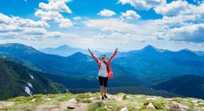 Happy hiker with her arms outstretched, freedom and happiness, achievement in mountains. royalty free stock photography