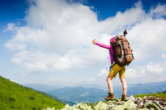 Happy hiker with her arms outstretched, freedom and happiness. In the mountains stock photos