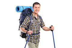 A happy hiker with hiking poles Royalty Free Stock Photography