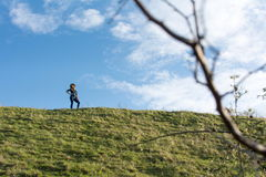 Happy hiker on the hill Royalty Free Stock Images