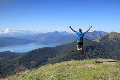 Happy hiker is jumping in nature. Happy hiker is jumping in the air in nature Royalty Free Stock Images