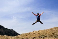 Happy hiker is jumping up Royalty Free Stock Photography