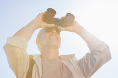 Happy hiker looking through binoculars Royalty Free Stock Photo