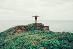 Happy hiker man enjoying view of sea Royalty Free Stock Photo
