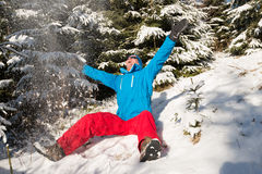 Happy hiker man having fun in sunny winter day in forest. Royalty Free Stock Photo