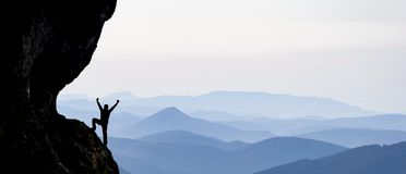 Happy hiker on mountain. A happy hiker celebration on the mountain side Stock Image
