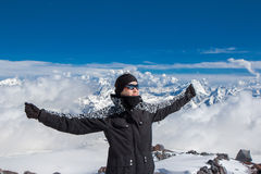 Happy hiker in the mountains. Smiling woman on the top of the mountain royalty free stock image