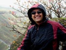 Happy hiker in raincoat Stock Photography