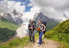 Happy hiker relax on beautiful mountains landscape royalty free stock images