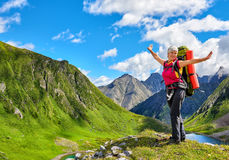 Happy hiker on top of hill in Siberian mountains. East Sayan. Russia Royalty Free Stock Images