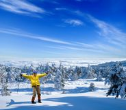 Happy hiker in a winter forest Stock Photo