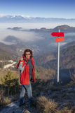 Happy hiker woman at mountain top showing ok sign Royalty Free Stock Image