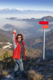 Happy hiker woman at mountain top waving hello Stock Images