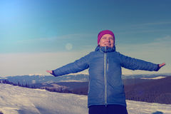 Happy hiker woman in winter mountains hugging the whole world, e Royalty Free Stock Photography