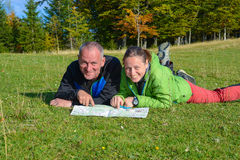 Happy hikers couple are having fun , when they are planning thei Royalty Free Stock Photo