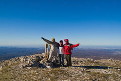 Happy hikers on mount summit. Happy hikers wave their hands  on mountain summit Stock Photography