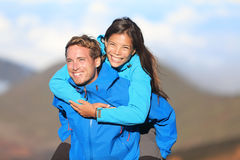 Happy hiking couple piggyback Royalty Free Stock Image