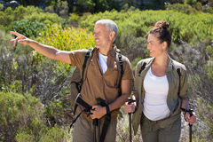 Happy hiking couple standing looking at something Stock Photo