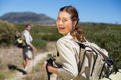 Happy hiking couple walking on country trail Royalty Free Stock Image