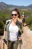 Happy hiking couple walking on mountain trail Stock Photos