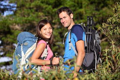 Happy hiking friends / couple hikers in forest Stock Photos