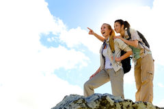 Happy hiking girls stock images
