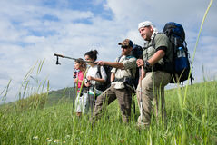 Happy hiking group. A group of hikers enjoying a sunny day royalty free stock photography