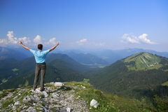 Happy hiking man on mountain Royalty Free Stock Images