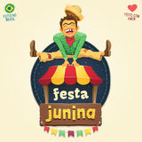 Happy hillbilly jumping over tent logo - Brazilian June Party Stock Image