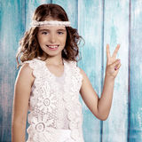 Happy hippie children girl smiling with peace hand sign Stock Photography