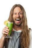 Happy hippie drinking a green vegetable smoothie. Funny portrait of a very happy hippie man drinking a green vegetable smoothie. Isolated on white Royalty Free Stock Photography