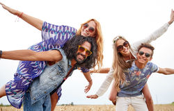 Happy hippie friends having fun on cereal field Royalty Free Stock Images