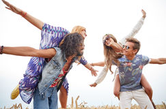 Happy hippie friends having fun on cereal field Royalty Free Stock Image