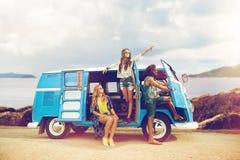 Happy hippie friends in minivan car on island Royalty Free Stock Photo