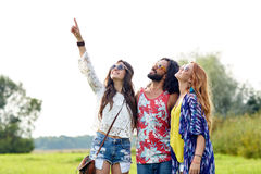 Happy hippie friends pointing finger outdoors Royalty Free Stock Photos